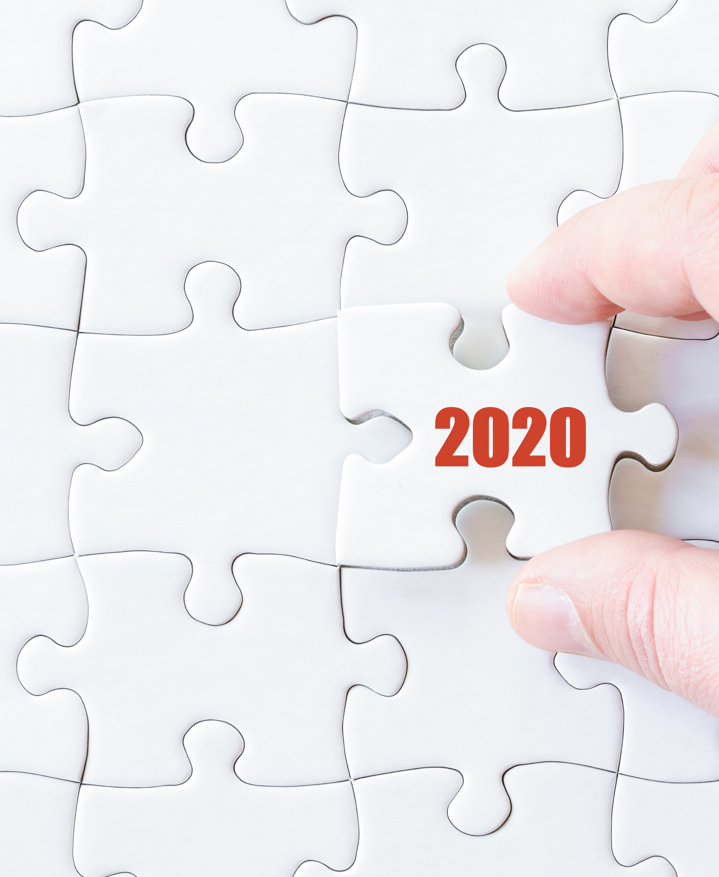 Missing jigsaw puzzle piece with  year  2020. Business concept image for completing the puzzle.